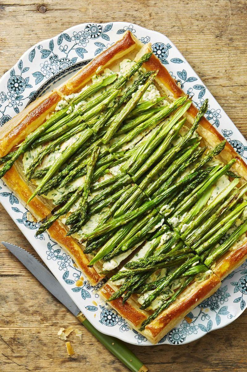 """<p>Zests of lemon, scallions, and herbs are hiding in the ricotta cheese base of this tart, meaning that there's a hefty hit of flavor coming with each bite.</p><p><em>Get the recipe from <a href=""""https://www.goodhousekeeping.com/food-recipes/a48174/roasted-asparagus-and-ricotta-tart-recipe/"""" rel=""""nofollow noopener"""" target=""""_blank"""" data-ylk=""""slk:Good Housekeeping"""" class=""""link rapid-noclick-resp"""">Good Housekeeping</a>.</em></p>"""