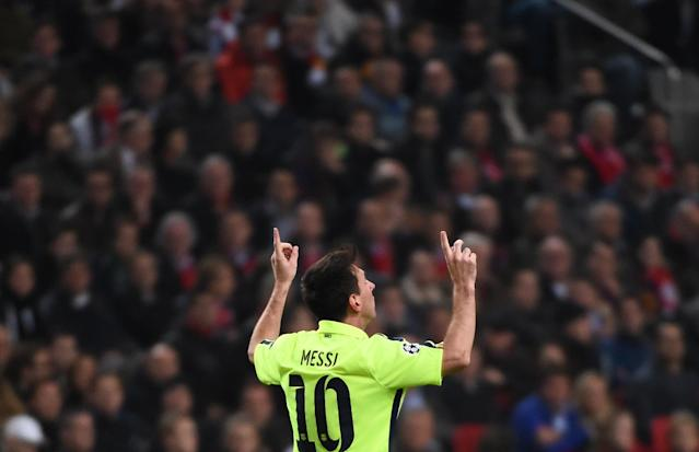 Barcelona's Argentinian forward Lionel Messi celebrates after scoring during the UEFA Champions League football match between Ajax Amsterdam and FC Barcelona in Amsterdam, November 5, 2014 (AFP Photo/Emmanuel Dunand)