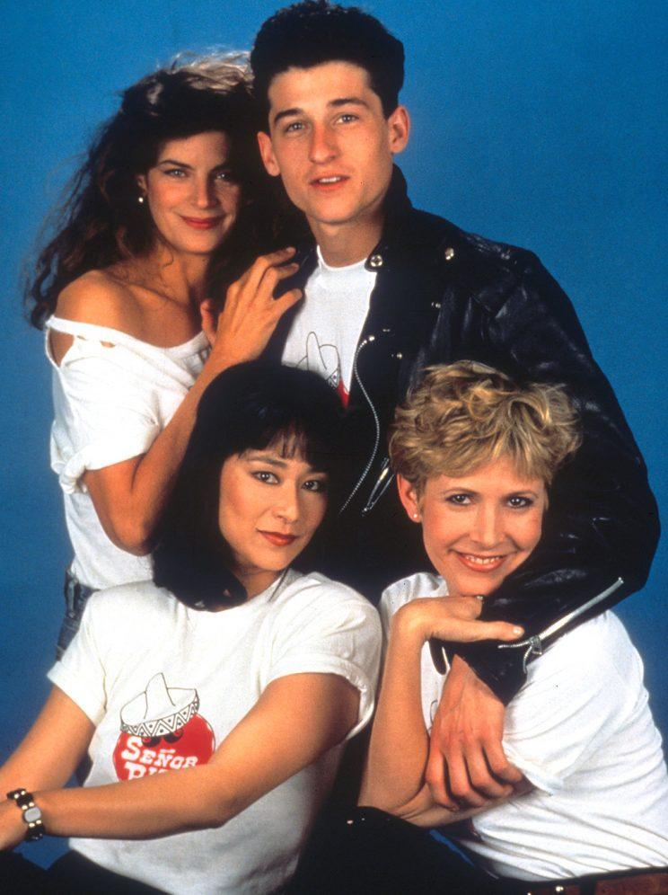 <p><em>Loverboy</em> from 1989, with Kirstie Alley, Patrick Dempsey, Carrie Fisher, and Kim Miyori. (Photo: Everett Collection)</p>