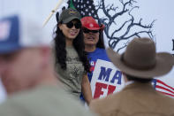 In this Saturday, Sept. 25, 2021, photo Republican congressional candidate Mayra Flores, left, attends a March to the Border event in McAllen, Texas. Flores argues that Democrats are forcing Texans choose between their energy sector jobs and curbing climate change. (AP Photo/Eric Gay)