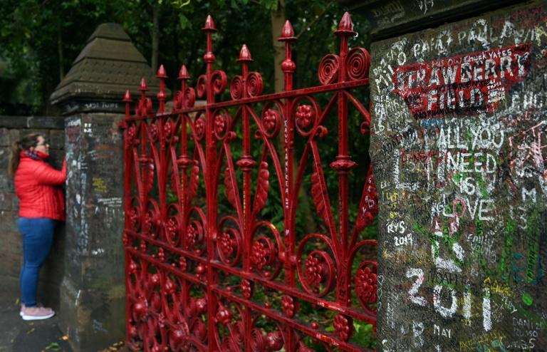 John Lennon used to climb over the fence from his aunt's house, where he grew up, and play with other children at the Strawberry Field Orphanage in Liverpool