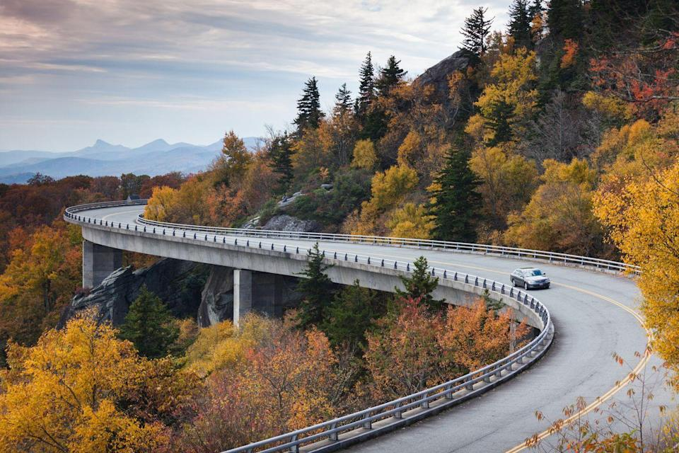 <p>The Linn Cove Viaduct, part of the Blue Ridge Parkway, wraps around the tree-covered base of Grandfather Mountain outside of Linville, North Carolina.</p>