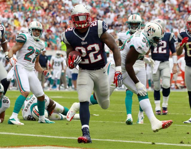 New England Patriots running back Stevan Ridley (22) scores a touchdown during the first half of an NFL football game against the Miami Dolphins, Sunday, Dec. 2, 2012 in Miami . (AP Photo/John Bazemore)