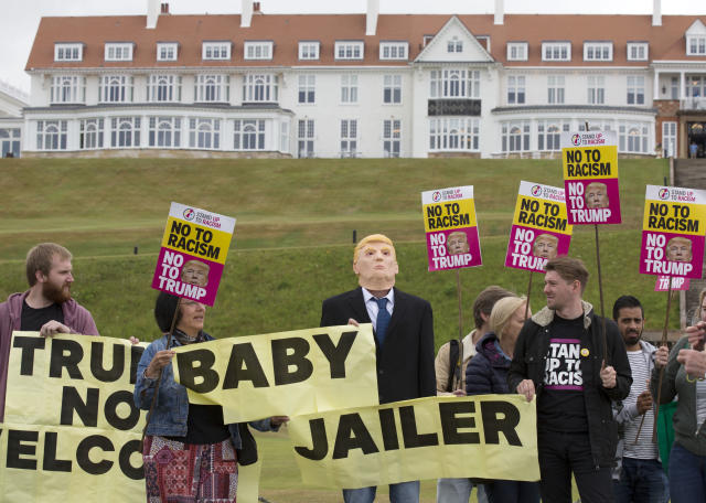 <p>Activists from Stand Up to Racism Scotland (SUTR) stage a protest at the Trump Turnberry resort ahead of the president's arrival in the UK, in South Ayrshire, Scotland, Wednesday, July 11, 2018. (Photo: David Cheskin/PA via AP) </p>