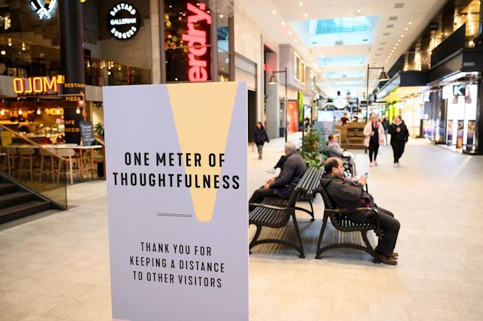 People socially distance in a Stockholm shopping center on May 12, 2020.