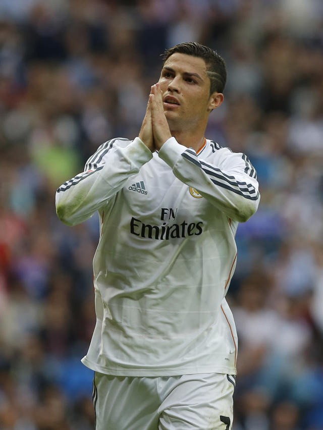 Real Madrid's Cristiano Ronaldo celebrates his goal during a Spanish La Liga soccer match against Malaga at the Santiago Bernabeu stadium in Madrid, Spain, Saturday, Oct. 19, 2013. (AP Photo/Andres Kudacki)