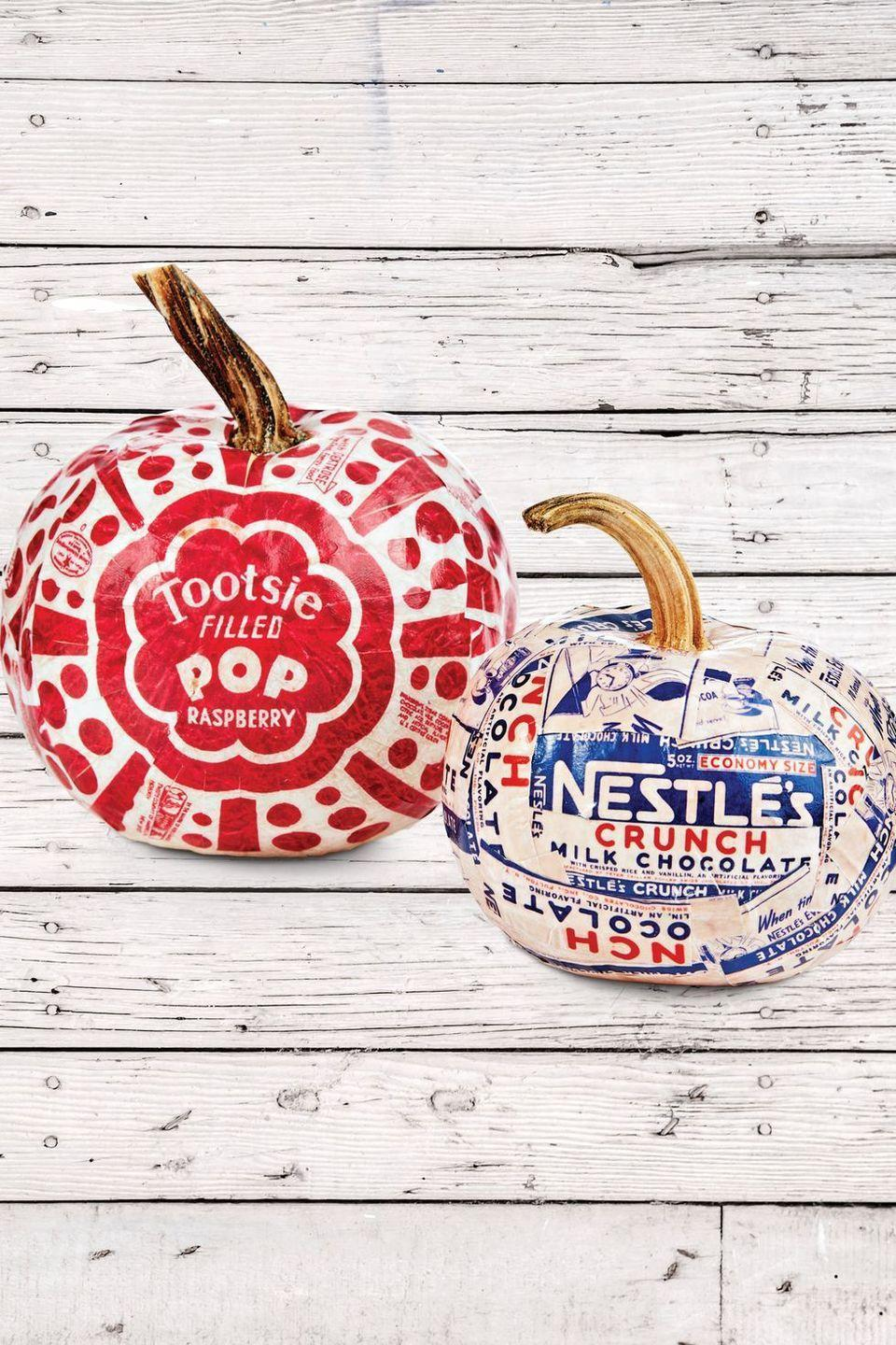 <p>You can never have too much candy on Halloween! Print out your favorite candy labels online, then cut them into 1-inch strips and attach to your pumpkins with Mod Podge.</p>