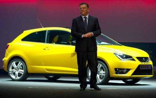 Seat President and CEO James Muir displays a Seat Ibiza Cupra car