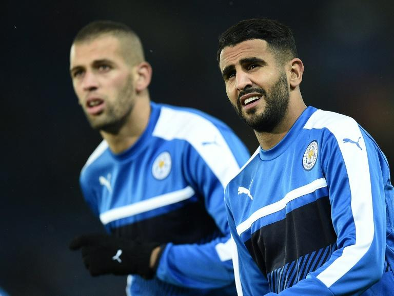 Leicester City's Islam Slimani (L) and Riyad Mahrez warm up ahead of an UEFA Champions League match at the King Power Stadium in Leicester, in October 2016