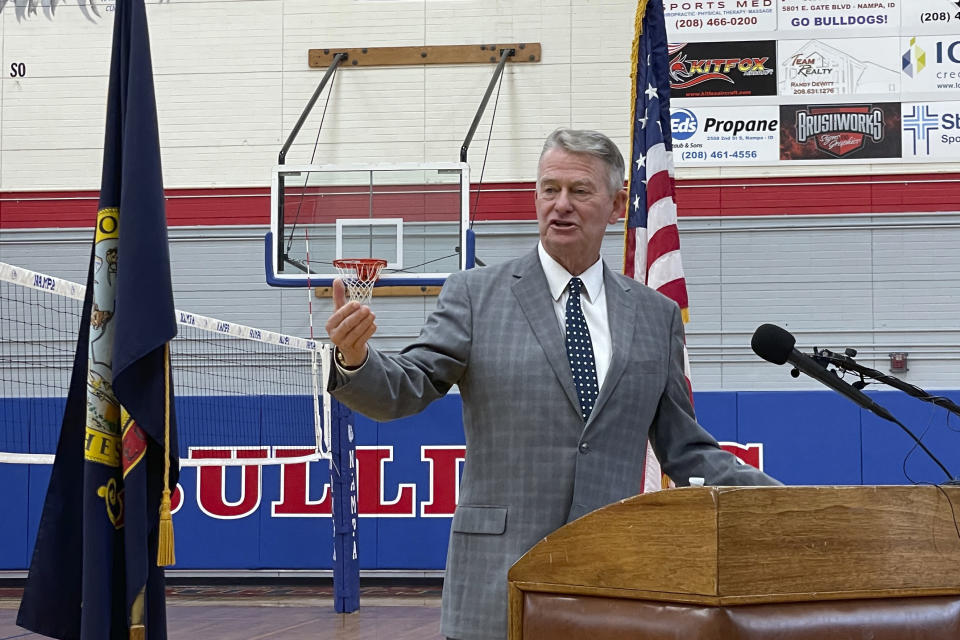 FILE - In this Aug. 12, 2021 file photo, Idaho Gov. Brad Little urges people to get vaccinated against the coronavirus during a visit to Nampa High School in Nampa Idaho. Mainstream Idaho Republicans who support Little are concerned about a takeover by the surging far-right wing of the party are asking Democrats, Independents or other affiliated voters to register as Republicans to vote in the party's May primary. (AP Photo/Keith J. Ridler, File)