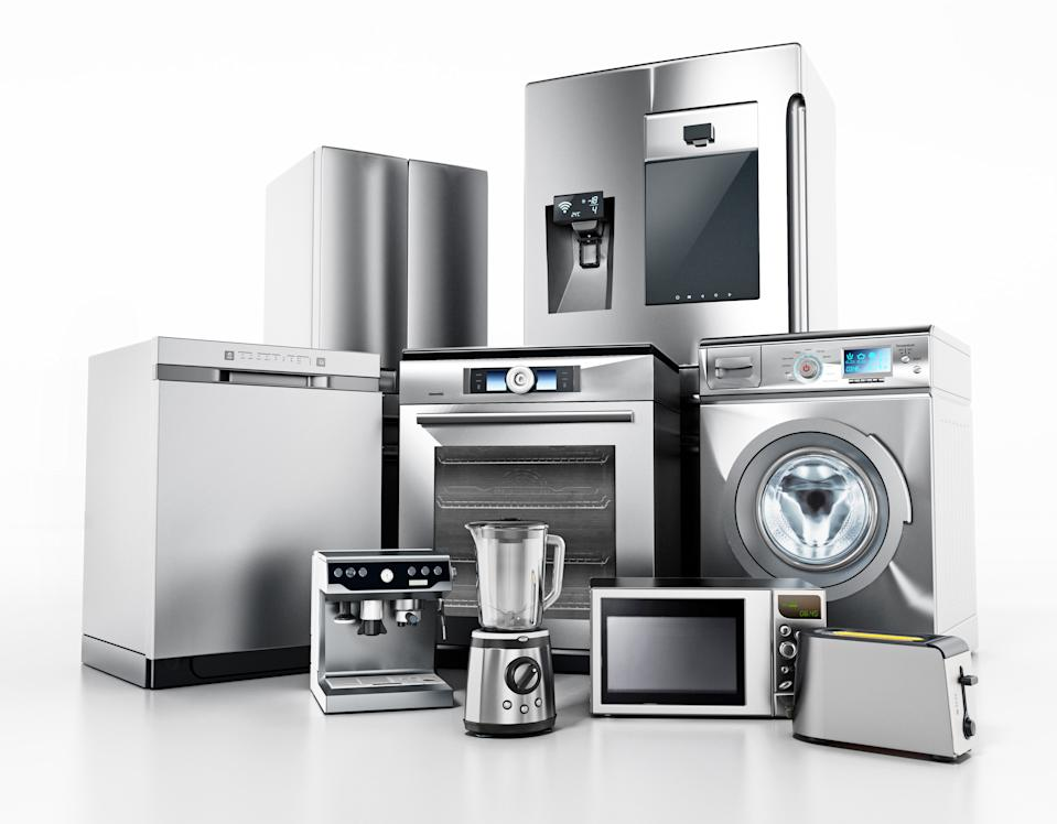 Set of contemporary house appliances isolated on white.