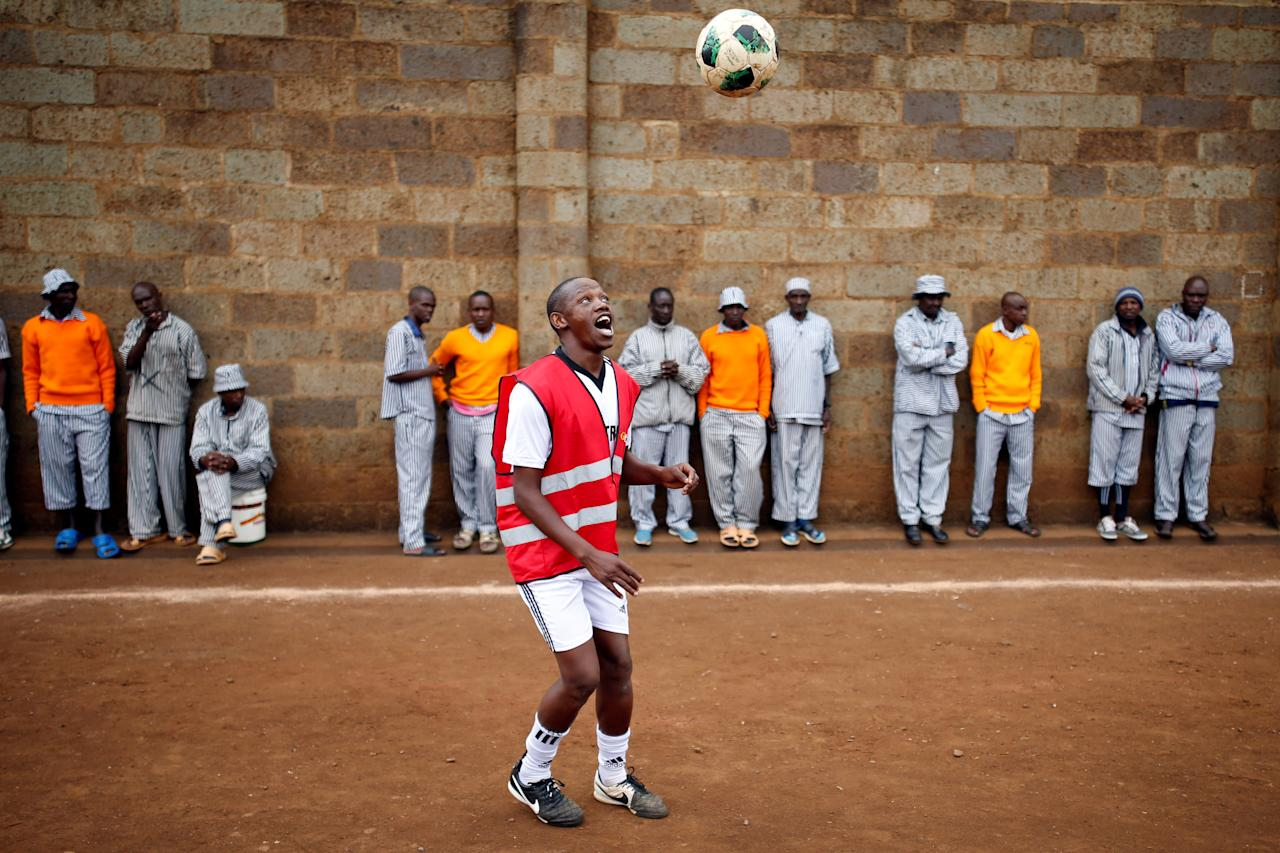 <p>A prisoner warms up before the start of a mock World Cup soccer match between Russia and Saudi Arabia as part of a monthlong soccer tournament involving eight prison teams at the Kamiti Maximum Security Prison near Nairobi, Kenya, on June 14, 2018. (Photo: Baz Ratner/Reuters) </p>