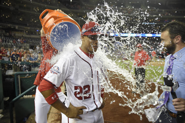 Washington Nationals' Juan Soto is doused after a baseball game against the San Diego Padres, Monday, May 21, 2018, in Washington. The Nationals won 10-2. (AP Photo/Nick Wass)