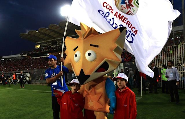 A man dressed as the mascot of the Copa America Chile 2015 walks around the field before the friendly match between Chile and Uruguay in Santiago, on November 18, 2014 . AFP PHOTO/MARTIN BERNETTI (Photo credit should read MARTIN BERNETTI/AFP/Getty Images)