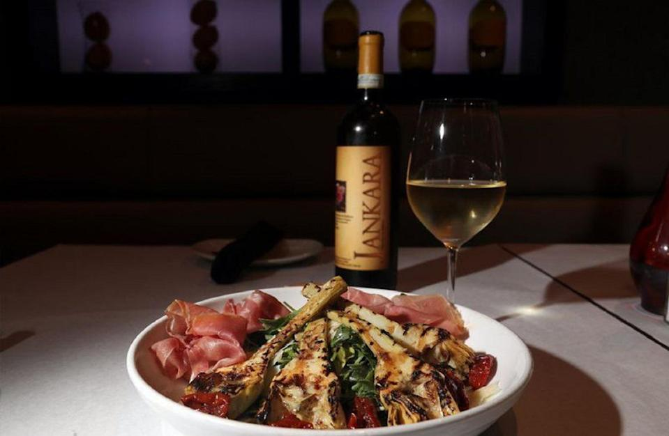 """<p>Enjoy the fresh flavors of this Italian dish, starring grilled marinated artichokes set on top of a bed of zesty arugula. If you eat meat, a little prosciutto makes this salad even better than a <a href=""""https://www.thedailymeal.com/charcuterie-board-shopping-list-ideas-holidays-thanksgiving?referrer=yahoo&category=beauty_food&include_utm=1&utm_medium=referral&utm_source=yahoo&utm_campaign=feed"""" rel=""""nofollow noopener"""" target=""""_blank"""" data-ylk=""""slk:charcuterie board"""" class=""""link rapid-noclick-resp"""">charcuterie board</a>.</p> <p><a href=""""https://www.thedailymeal.com/grilled-artichokes-recipe?referrer=yahoo&category=beauty_food&include_utm=1&utm_medium=referral&utm_source=yahoo&utm_campaign=feed"""" rel=""""nofollow noopener"""" target=""""_blank"""" data-ylk=""""slk:For the Grilled Artichokes With Citronette Dressing recipe, click here."""" class=""""link rapid-noclick-resp"""">For the Grilled Artichokes With Citronette Dressing recipe, click here.</a></p>"""