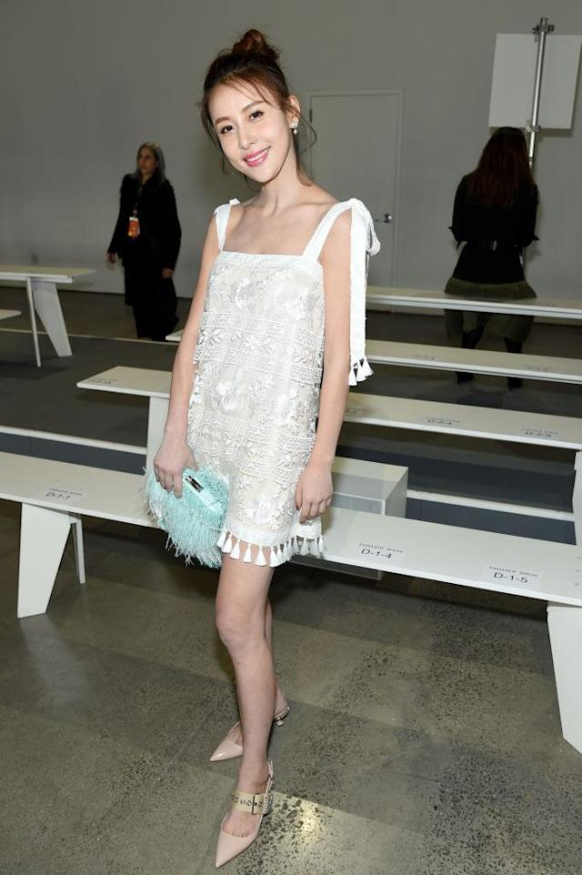 <p>The Chinese actress was thinking sunny thoughts in a bohemian tassel dress and mint green bag. (Photo: Getty Images) </p>
