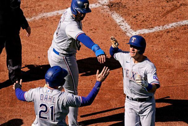 PHOTO: Texas Rangers' Nick Solak, right, celebrates with Joey Gallo (13) and David Dahl (21) during the first inning against the Kansas City Royals, April 1, 2021, in Kansas City, Mo. (Charlie Riedel/AP, FILE)