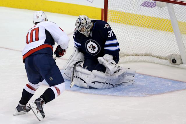 Washington Capitals' Martin Erat (10) scores the game-winning goal in a shootout against Winnipeg Jets' goaltender Ondrej Pavelec (31) during an NHL hockey game in Winnipeg, Manitoba, Tuesday, Oct. 22, 2013. The Capitals won 5-4 in a shootout. (AP Photo/The Canadian Press, Trevor Hagan)