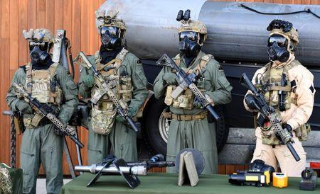 Special Operations Command soldiers stand together as they pose for members of the media at the Australian Army's Holsworthy Barracks located in western Sydney, Australia, July 17, 2017.    AAP/Brendan Esposito/via REUTERS