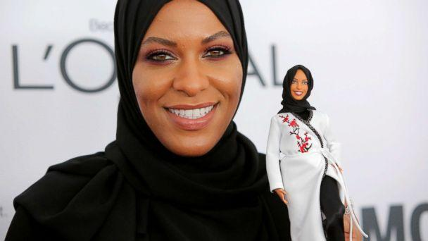PHOTO: Olympic fencer Ibtihaj Muhammad holds a Barbie doll made in her likeness as she attends the 2017 Glamour Women of the Year Awards at the Kings Theater in Brooklyn, New York, Nov. 13, 2017. (Andrew Kelly/Reuters)