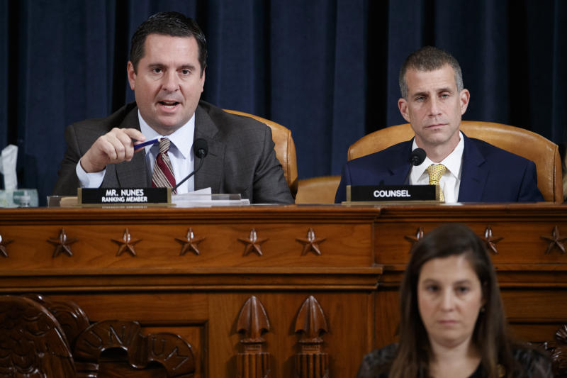 Ranking member Rep. Devin Nunes of Calif., left, and Steve Castor, the Republican staff attorney, right, speaking during testimony by Jennifer Williams, an aide to Vice President Mike Pence, and National Security Council aide Lt. Col. Alexander Vindman, before the House Intelligence Committee on Capitol Hill in Washington, Tuesday, Nov. 19, 2019, during a public impeachment hearing of President Donald Trump's efforts to tie U.S. aid for Ukraine to investigations of his political opponents. (Shawn Thew/Pool Photo via AP)