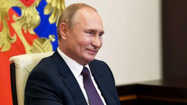 PHOTO: Russian President Vladimir Putin smiles as he attends a meeting via video conference at the Novo-Ogaryovo residence outside Moscow, Russia, Aug. 20, 2020. (Kremlin Pool Photo via AP, FILE)