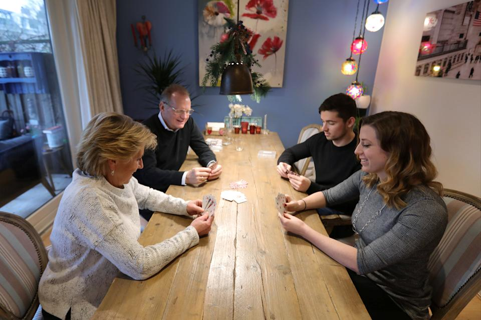 Indy Mellink's family and her boyfriend play cards at home in Oegstgeest, the NetherlandsREUTERS