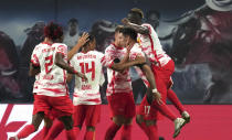Leipzig's Dominik Szoboszlai, second right, celebrates with teammates after scoring the opening goal of the match during the German Bundesliga soccer match between RB Leipzig and VfB Stuttgart in Leipzig, Germany, Friday, Aug. 20, 2021. (AP Photo/Michael Sohn)