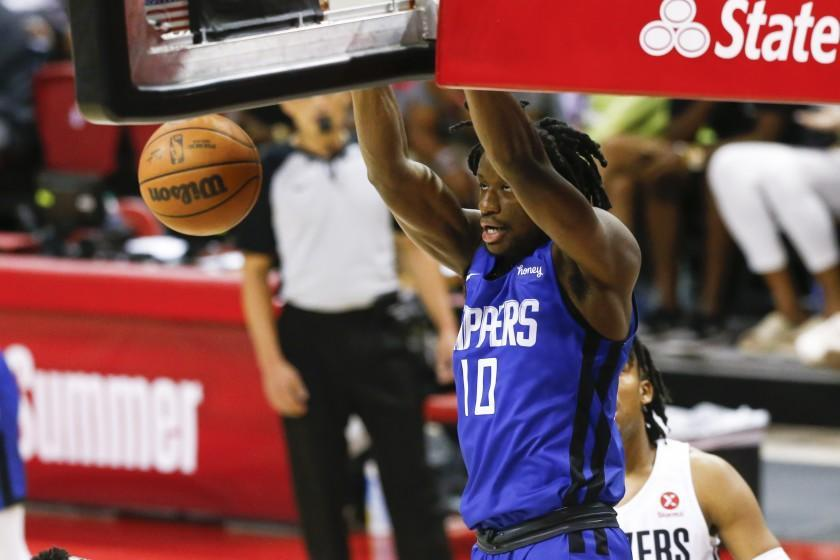Los Angeles Clippers' Daniel Oturu (10) dunks against the Portland Trail Blazers during the first half of an NBA summer league basketball game Tuesday, Aug. 10, 2021, in Las Vegas. (AP Photo/Chase Stevens)