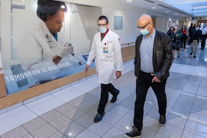 Moncef Slaoui, right, tours Temple University Hospital with Tony Reed, chief medical officer, on Nov. 20. Slaoui is co-director of Operation Warp Speed, the Trump administration's effort to rapidly develop, manufacture and distribute COVID-19 vaccines and treatments.