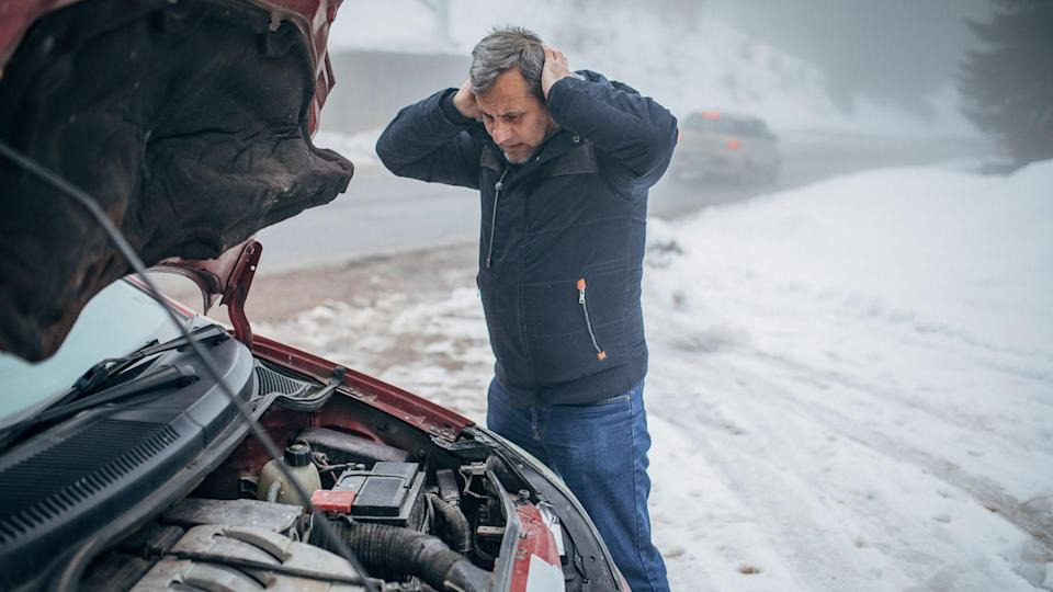 Car breakdown on the road in winter conditions.