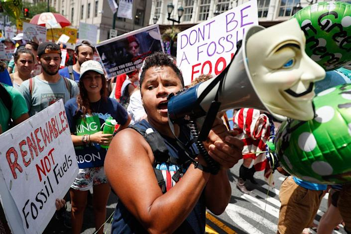 <p>A protestor chants through a megaphone as he marches during a demonstration in downtown on Sunday, July 24, 2016, in Philadelphia. The Democratic National Convention starts Monday. (AP Photo/John Minchillo)</p>