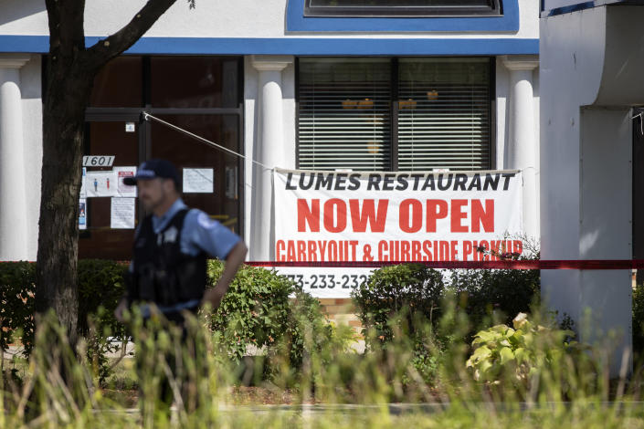 Chicago police officers work at the scene where multiple people were shot, one fatally, at Lumes Pancake House Sunday, Aug. 30, 2020, on Chicago's far South Side. (Erin Hooley/Chicago Tribune via AP)