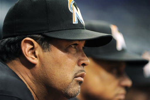 Miami Marlins manager Ozzie Guillen watches from the dugout during the eighth inning of an interleague baseball game against the Tampa Bay Rays, Sunday, June 17, 2012, in St. Petersburg, Fla. The Rays won 3-0. (AP Photo/Brian Blanco)