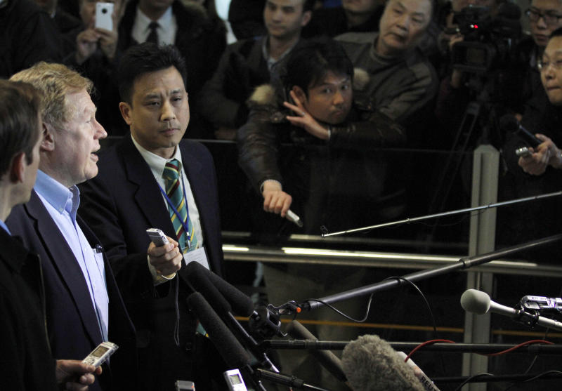U.S. Special Envoy for North Korean human rights issues, Robert King, second from left speaks to journalists upon his arrival at the airport in Beijing, China, Tuesday, March 6, 2012. (AP Photo/Ng Han Guan)