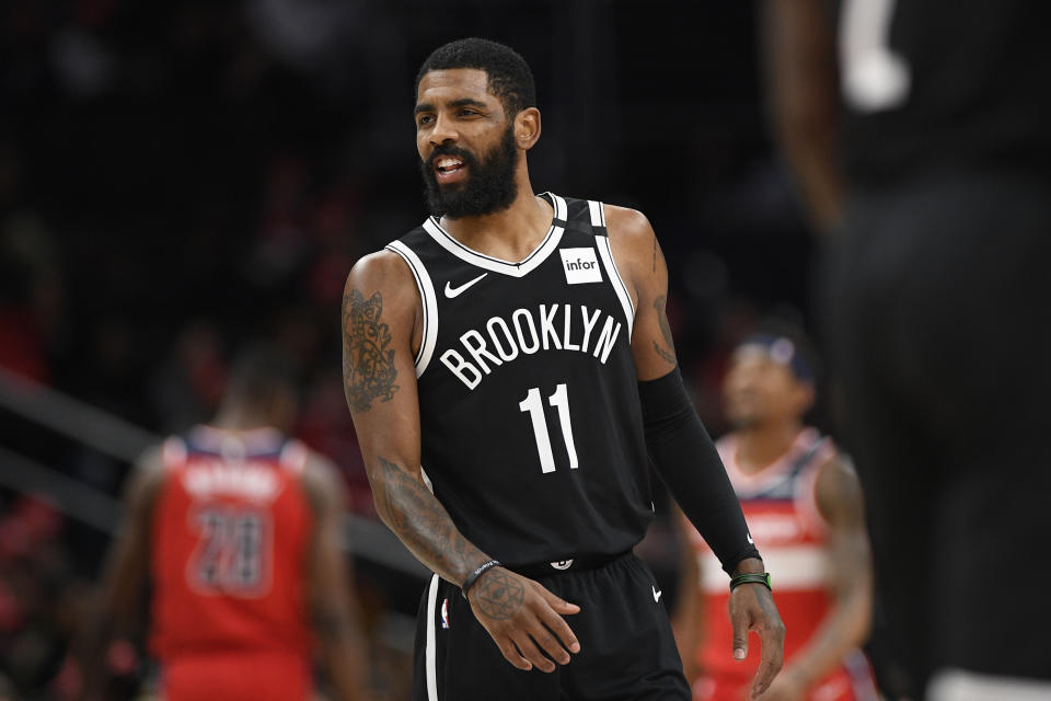 Brooklyn Nets guard Kyrie Irving (11) reacts during the first half of an NBA basketball game against the Washington Wizards, Saturday, Feb. 1, 2020, in Washington. (AP Photo/Nick Wass)