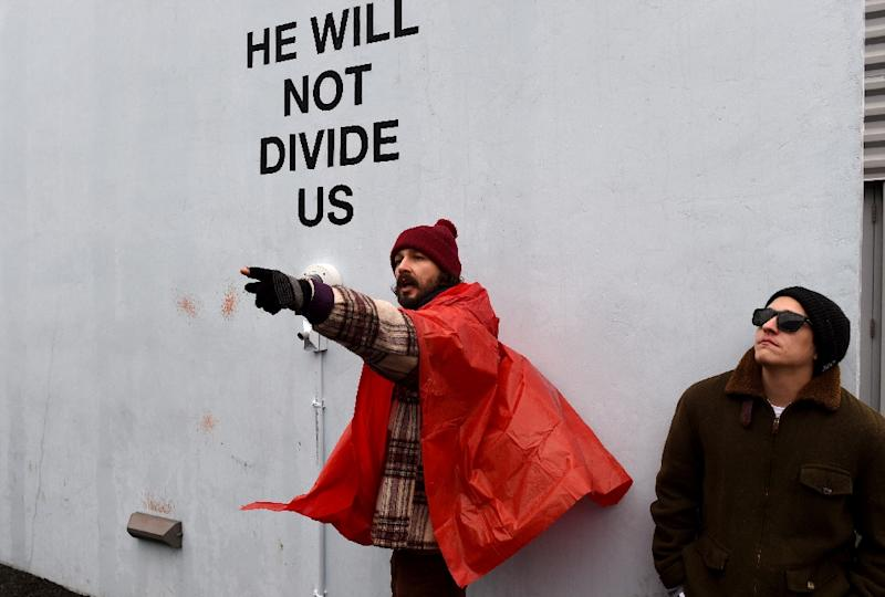US actor Shia LaBeouf (on left) first installed his artistic protest against President Donald Trump in New York, but it has moved several times after coming under attack