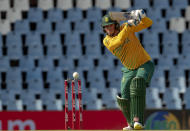 South Africa's batman Rassie van der Dussen watches his shot during the fourth and final T20 cricket match between South Africa and Pakistan at Centurion Park in Pretoria, South Africa, Friday, April 16, 2021. (AP Photo/Themba Hadebe)
