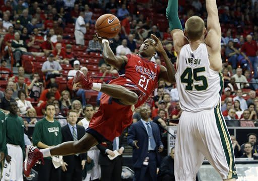 Fresno State's Allen Huddleston, shoots against Colorado State's Colton Iverson during the first half of a Mountain West Conference tournament NCAA college basketball game on Wednesday, March 13, 2013, in Las Vegas. (AP Photo/Isaac Brekken)