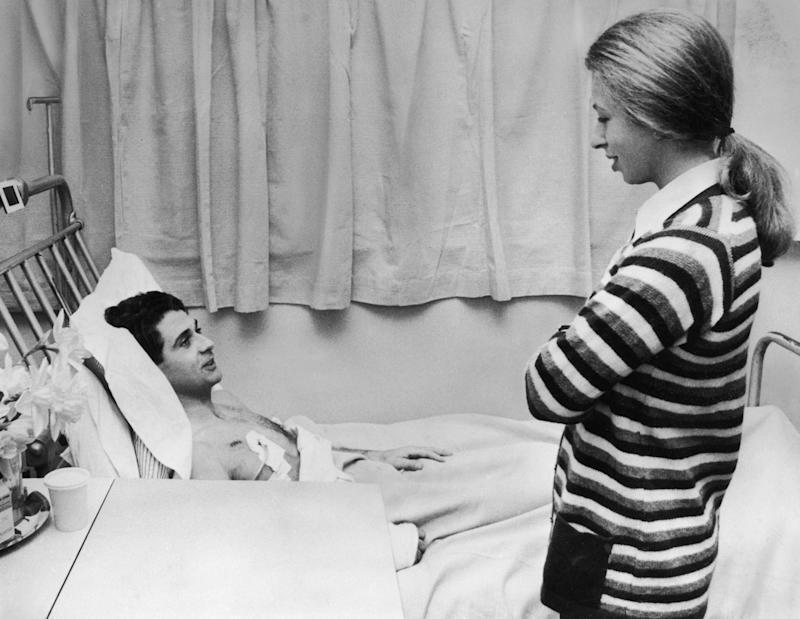 A photo of Princess Anne visiting her bodyguard, Inspector James Beaton, at Westminster Hospital in London where he was recovering from gunshot wounds sustained during the attempt to kidnap the Princess in the Mall, 25th March 1974.