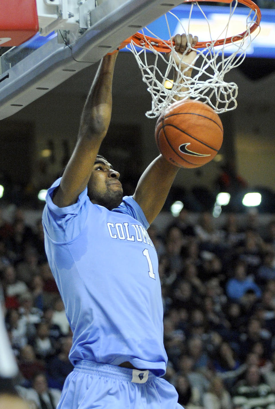 Columbia's Jeff Coby (1) scores during the first half of an NCAA college basketball game against Connecticut in Bridgeport, Conn., Monday, Dec. 22, 2014. (AP Photo/Fred Beckham)