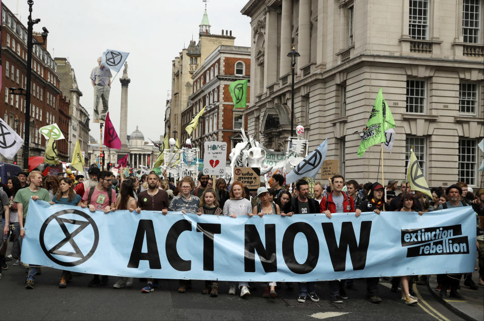 "FILE - In this Tuesday April 23, 2019 file photo, climate change protesters march along Whitehall toward parliament, in London. Britain's prime minister has announced plans to eliminate the country's net contribution to climate change by 2050. Theresa May said the plan will be put before Parliament Wednesday, June 12. She says the amendment to the 2008 Climate Change Act will intensify Britain's push to drastically reduce carbon emissions because ""standing by is not an option."" (AP Photo/Matt Dunham, file)"
