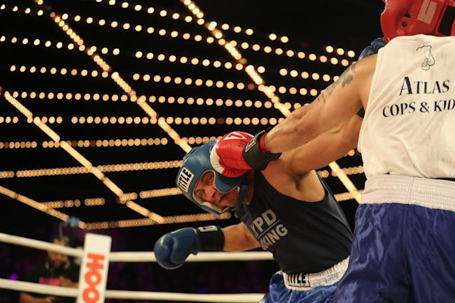 <p>Robert Cruz (red) lands a punch against Johnny Orellano (blue) in the Executive Decision Match during the NYPD Boxing Championships at the Hulu Theater at Madison Square Garden on March 15, 2018. (Gordon Donovan/Yahoo News) </p>