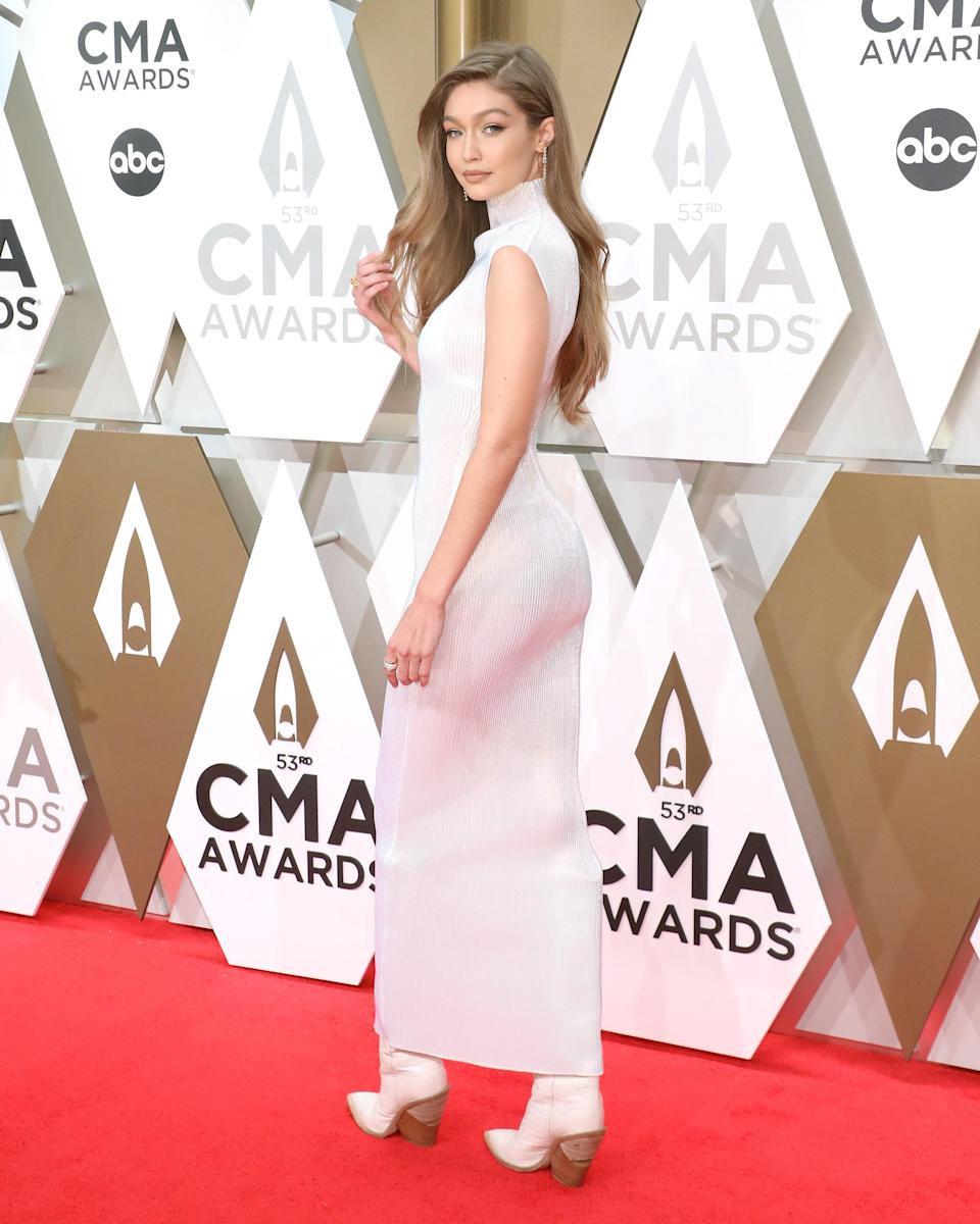 Gigi attended the 53nd annual CMA Awards in Tennessee wearing this figure-hugging dress. Of curse, the occasion called for some boots.