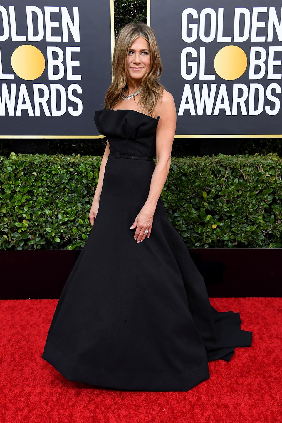"""Nominated for her role on """"The Morning Show,"""" Aniston went full glam in a belted black ballgown. (Photo by Steve Granitz/WireImage)"""