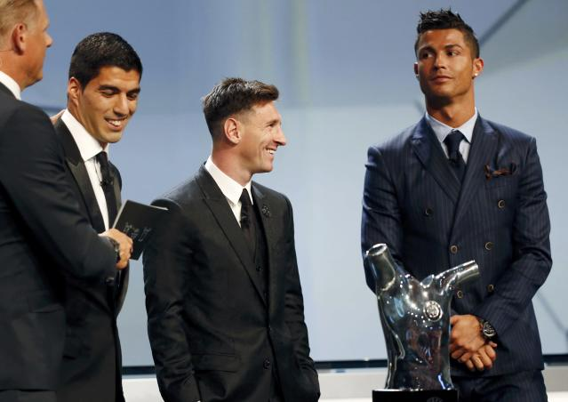 (L-R) The three nominees for the Best Player UEFA 2015, Barcelona's Luis Suarez, Barcelona's Lionel Messi and Real Madrid's Cristiano Ronaldo attend the Best Player UEFA 2015 Award ceremony during the draw ceremony for the 2015/2016 Champions League Cup soccer competition at Monaco's Grimaldi Forum in Monte Carlo August 27, 2015. REUTERS/Eric Gaillard