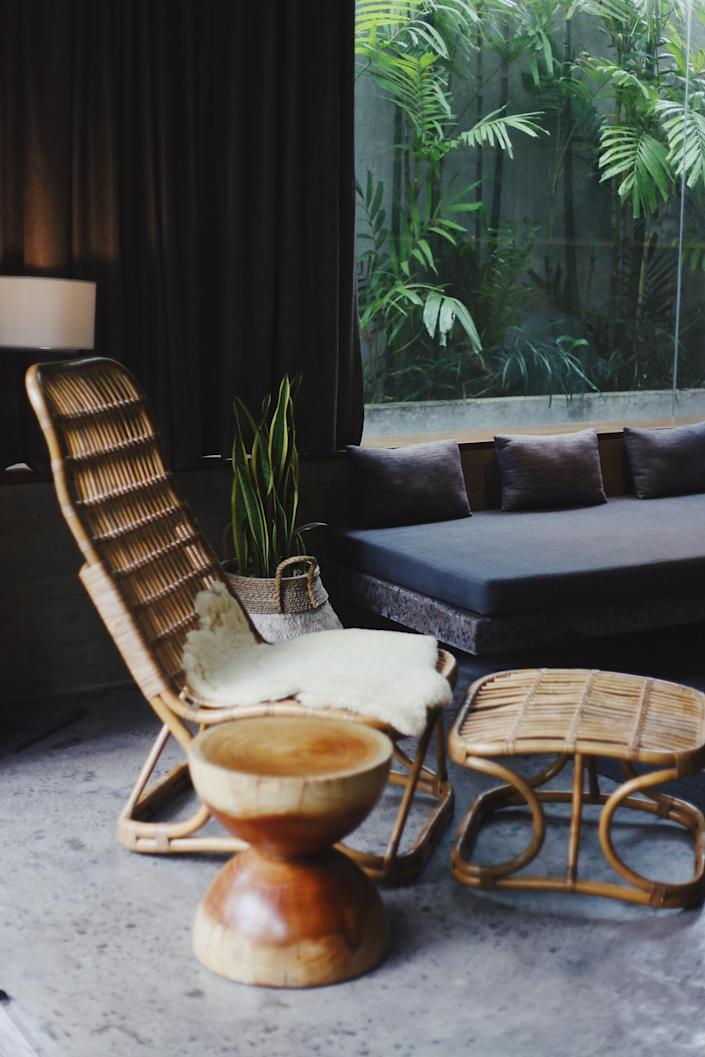Laid-back rattan chair in a breezy interior