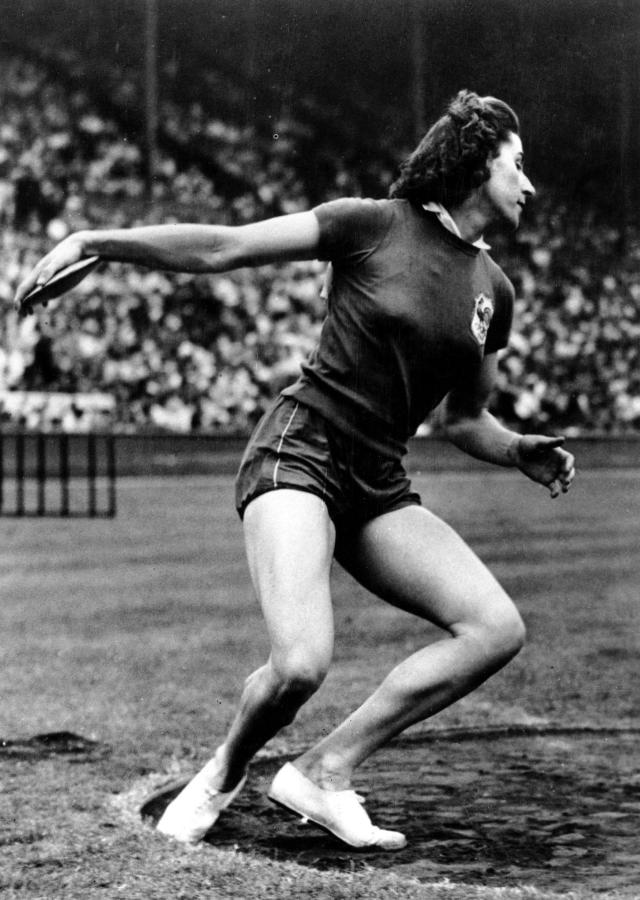 Micheline Ostermeyer of France winds up to throw the discus during the XIV Summer Olympic Games in the women's discus meet at Wembly Stadium in London, England on July 31, 1948. (AP Photo)