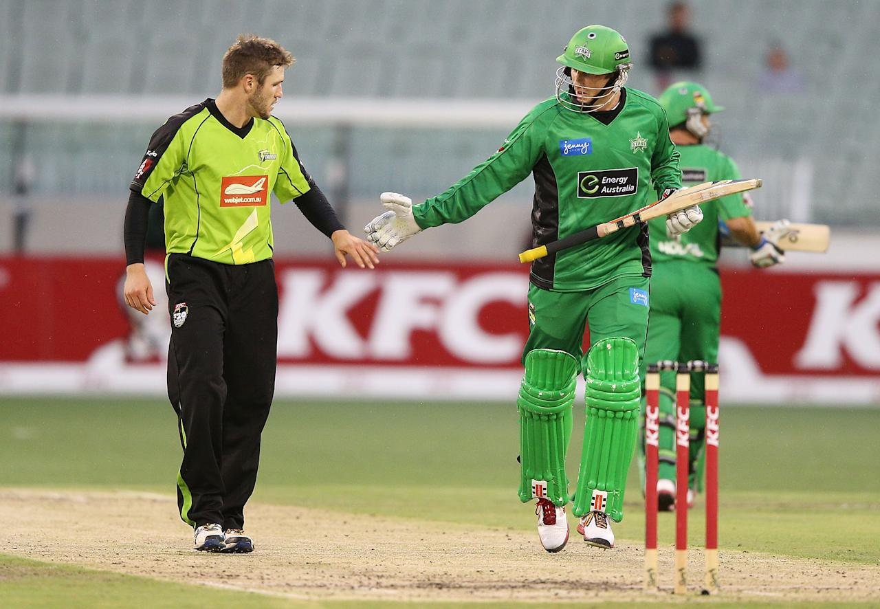 MELBOURNE, AUSTRALIA - JANUARY 08:  Simon Keen (L) of the Sydney Thunder is forgiven by David Hussey of the Melbourne Stars for bowling a dangerous full toss during the Big Bash League match between the Melbourne Stars and the Sydney Thunder at Melbourne Cricket Ground on January 8, 2013 in Melbourne, Australia.  (Photo by Michael Dodge/Getty Images)