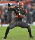 FILE - In this Sept. 20, 2018, file photo, Cleveland Browns defensive end Myles Garrett (95) celebrates a sack during an NFL football game against the New York Jets, in Cleveland. General manager John Dorsey has revamped the Cleveland Browns roster. From hopeless to hopeful. Finally. (AP Photo/David Richard, File)